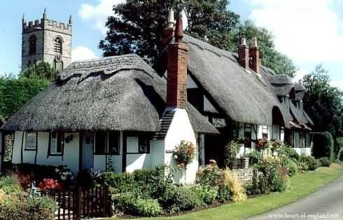 The  picturesque  cottage  is in the village of Welford-on-Avon. It is constructed of stucco and half-timbering  with brick chimney stacks and a thatched roof.