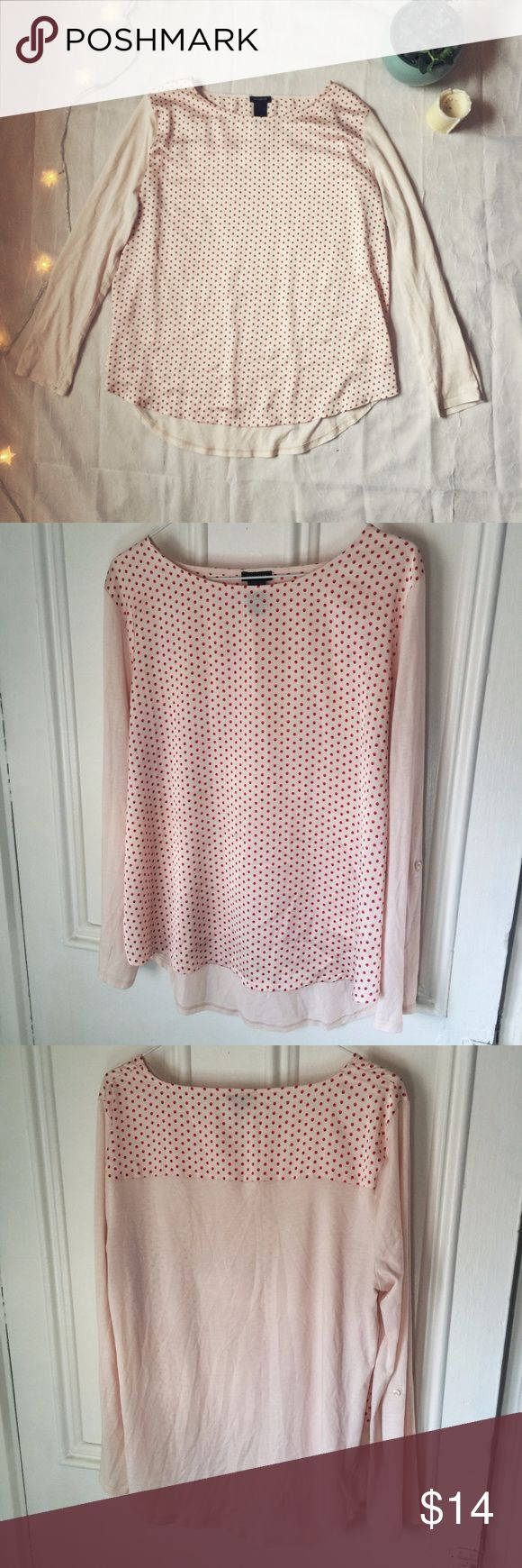"Ann Taylor polka dot blouse This blouse is in great condition and has a polyester, polka dot body and cotton/modal sleeves that can be buttoned up to 3/4 length. Size large.   Bust: 40"" Upper arm sleeve circumference: 18"" Ann Taylor Tops Blouses"