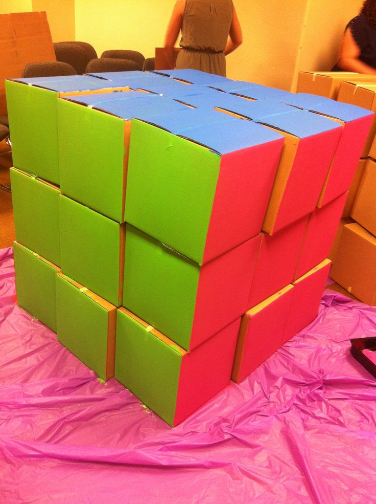 80's party Giant Rubix cube out of 12x12 cardboard boxes and acrylic paint.  Fun party game idea!