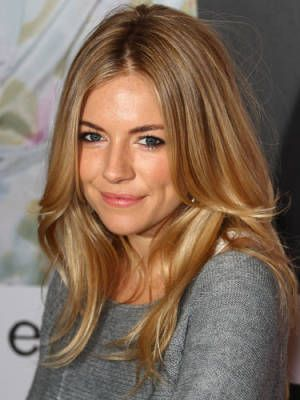 This hair color is so rich—like ribbons of honey and caramel. It has lots of pretty low-lights that frame Sienna's face in the most gorgeous way.