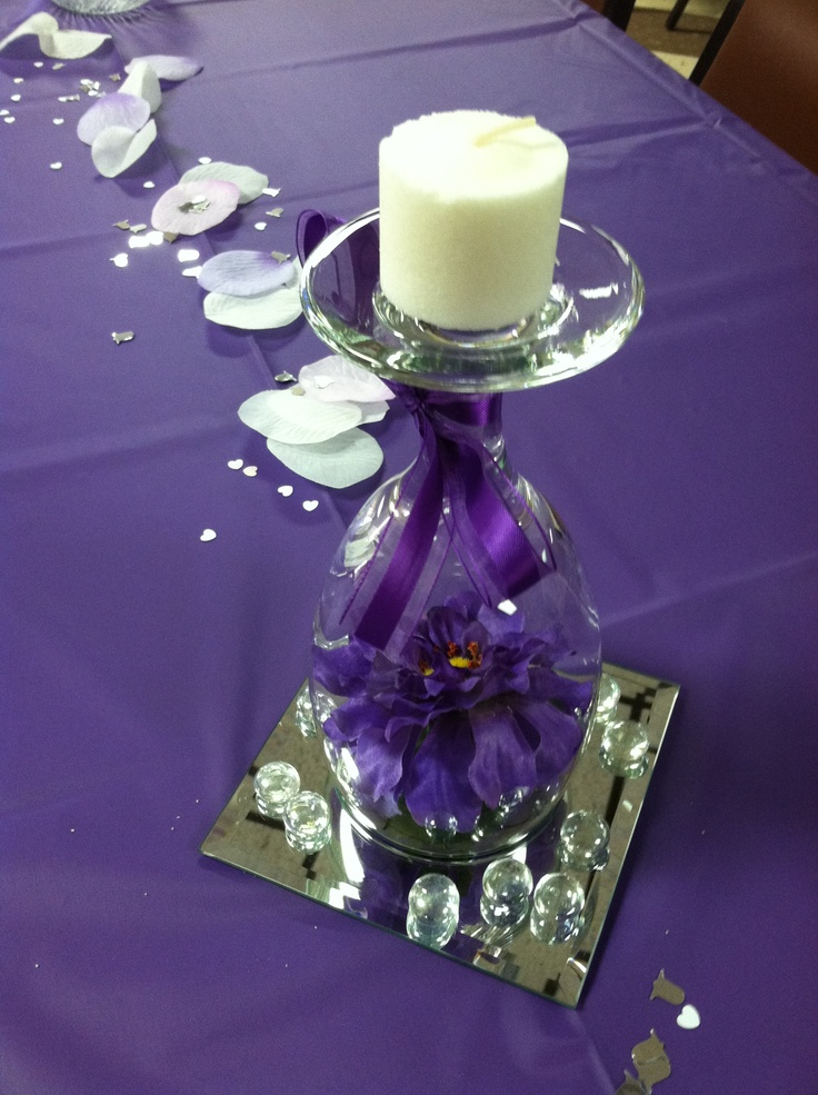 table decoration inverted wine glass containing silk flower sits atop a mirror base - Glass Decorations