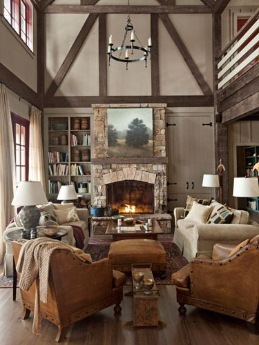 French leather club chairs offer plenty of seating in front of this fireplace. #decorating