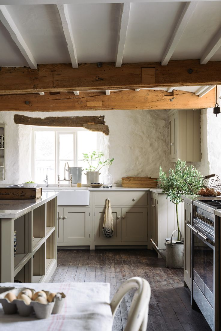 Old walls and new cupboards - the simplicity of the Shaker style is what makes this deVOL kitchen work so well in this 16th century water mill