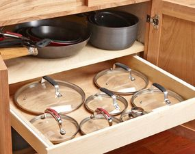 Mount a shallow rollout drawer under your pot shelf for easy access to your lids.