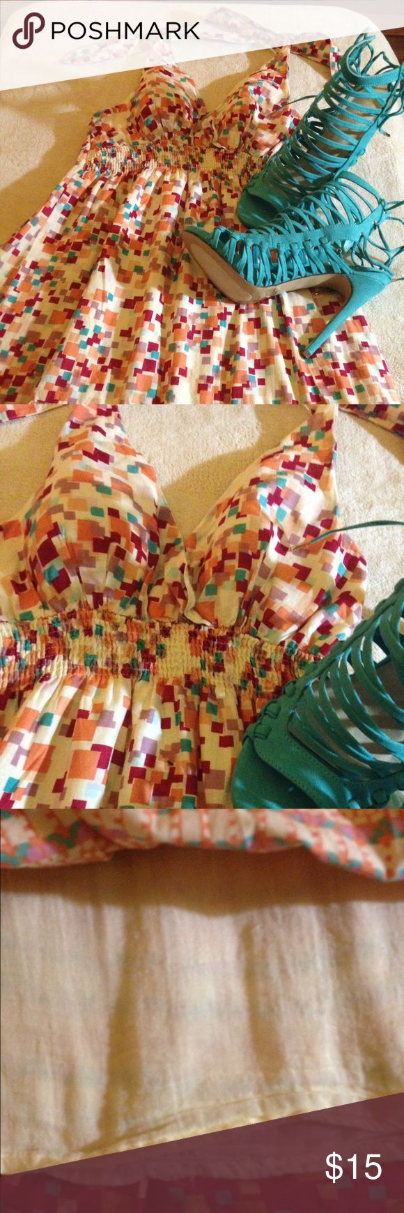 """Multi Colored Halter Dress It's hot somewhere! This colorful dress that ties around your neck is just right for a picnic, lunch, the beach , or your determination. The possibilities are endless. It has built in bra pads and a lining as well. 100% Cotton and length is 31"""" Up under the bodice it has elastic. 👗 Dresses"""