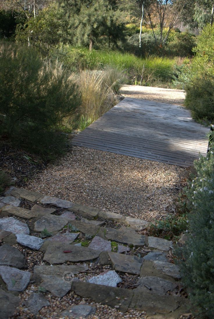 stonegravel path steps low planting with screening in background feels cosy but open