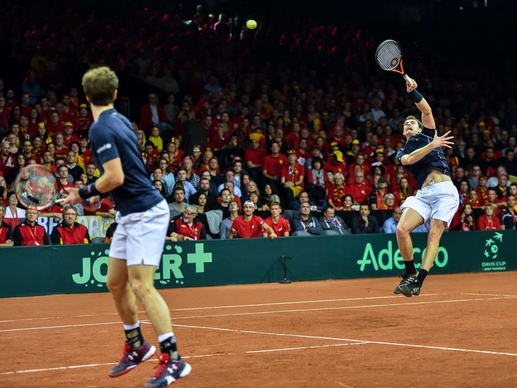 Jamie Murray, right, of Great Britain, plays a leaping return during a David Cup doubles match with partner Andy Murray in Ghent, Belgium. The Murrays defeated David Goffin and Steve Darcis of Belgium 6-4, 4-6, 6-3, 6-2 to move Great Britain within one point of winning the Davis Cup.  Philippe Huguen, AFP/Getty Images
