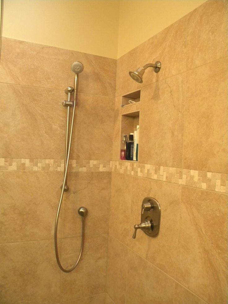 bathroom shower with carmel colored atlas travertini tile in an 18x18 the wrap is a - Bathroom Remodeling Columbus