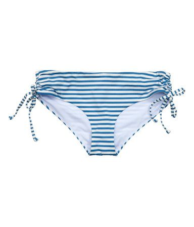 Sininen/Valkoraidallinen. Kokovuoratut bikinihousut, joissa säätönyöri sivuissa.