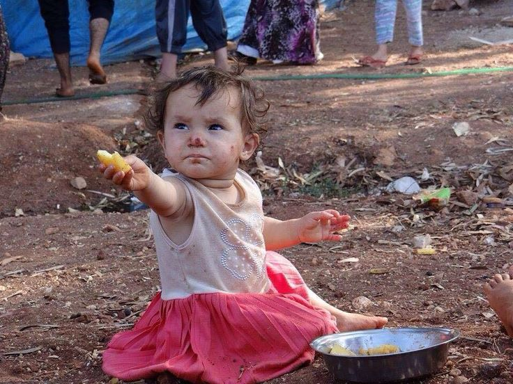 Syrian child refugee of war. We all love cute and  pretty kids in a happy state , but this kid's  childhood   is not as  happy and we have to work  as a humanity to make sure  that  we reduce  such occurrences.