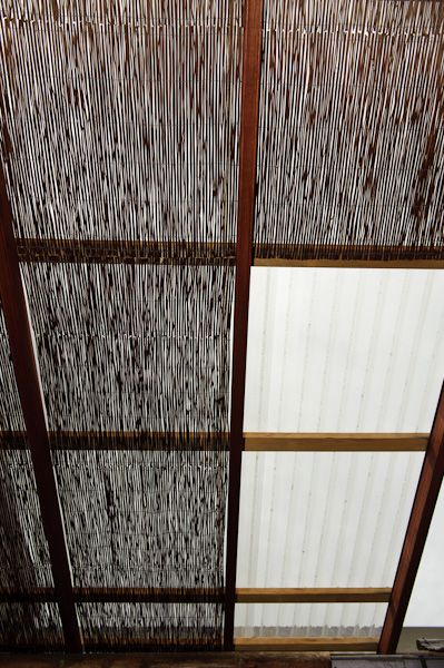 Roofing idea: rain protection from polycarbonate sheeting with bamboo/cane underneath for natural look