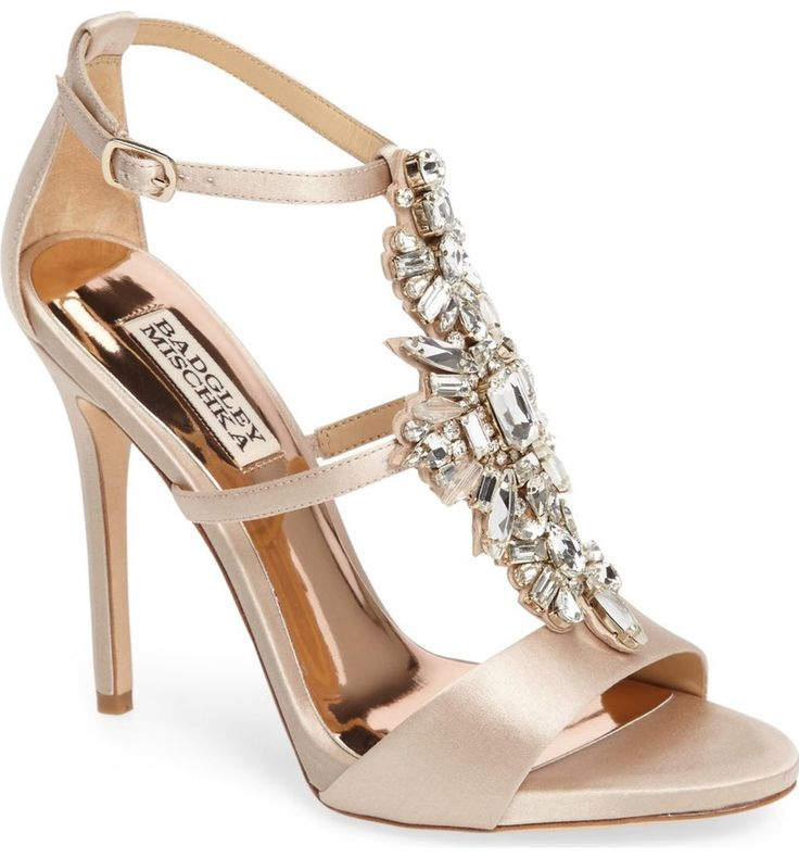 Decadent crystals sparkle along the T-strap of an event-ready sandal in lustrous satin.