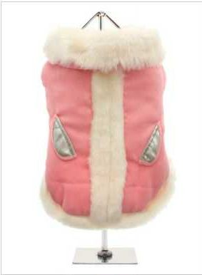 An elegant, soft faux suede coat that is perfect for that classy pup. The white fur trim creates a real princess feel, while the silver pockets add a glamorous touch. The pop-on pop-off buttons on the underside make it easy to take on and off your dog.