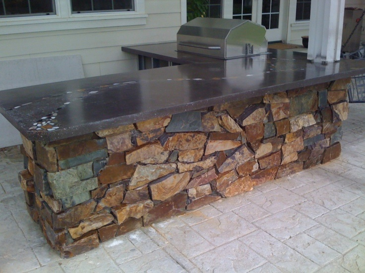 Outdoor Bar with custom polished concrete top. Fabricated