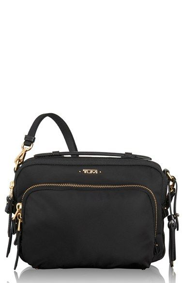 Free shipping and returns on Tumi 'Luanda' Crossbody Flight Bag at Nordstrom.com. A well-organized crossbody bag crafted from lightweight, rugged ballistic nylon is ideal for travel or everyday use. The sleek, streamlined silhouette offers a plethora of interior and exterior pockets for easy access to your phone and other essentials.