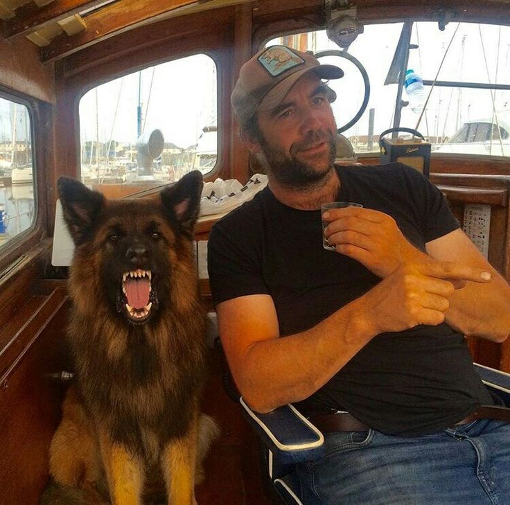Rory McCann in his element. On his boat with a hound.