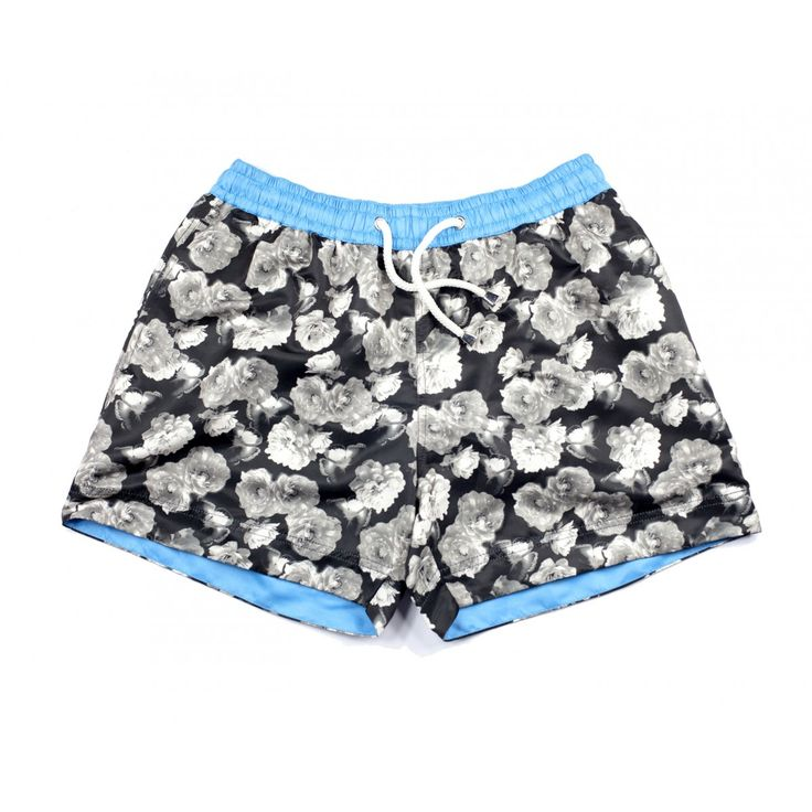 CANCUN FLORAL SHORTS | The Cancun floral shorts are ideal for the man who is looking to achieve a classic look with a modern twist this summer. The sophistication of black and white simply can't be beaten, which is why we have decided to create men's designer shorts with a vintage inspired look. Shop the collection at thomasroyall.com