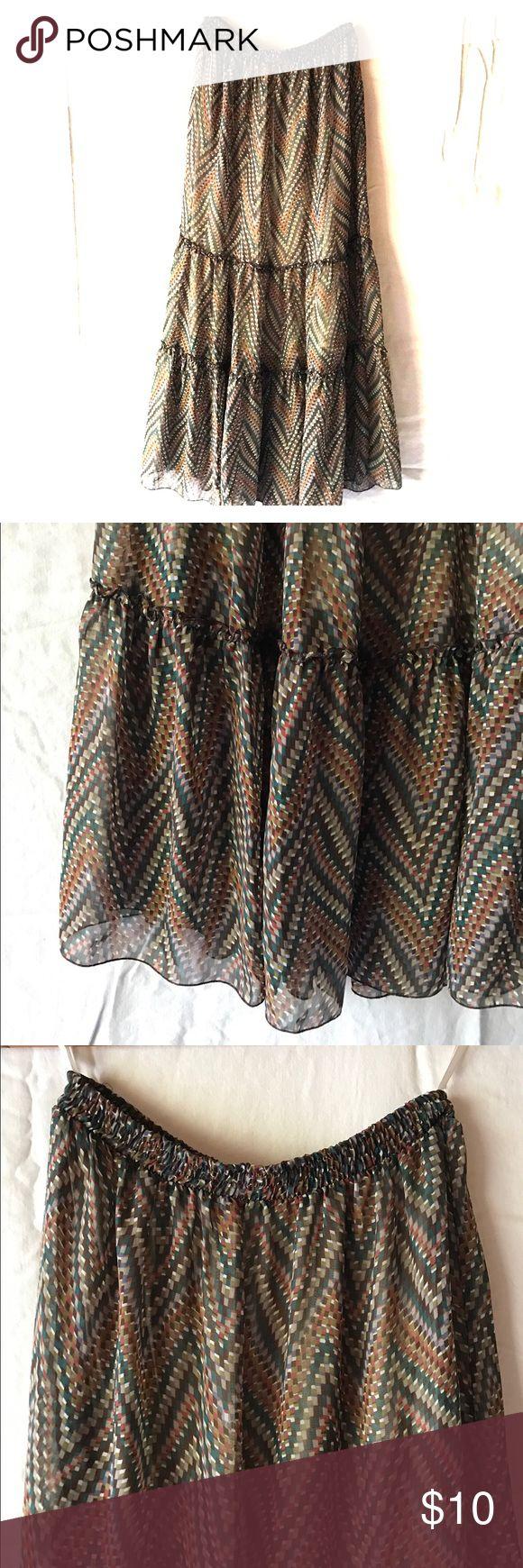 Flowy ruffled maxi skirt brown rust teal chevron Pretty flowy maxi skirt with ruffle tiers. Brown/rust/teal/orange chevron pattern sheer chiffon fabric with lining. Elastic waist. Skirts Maxi