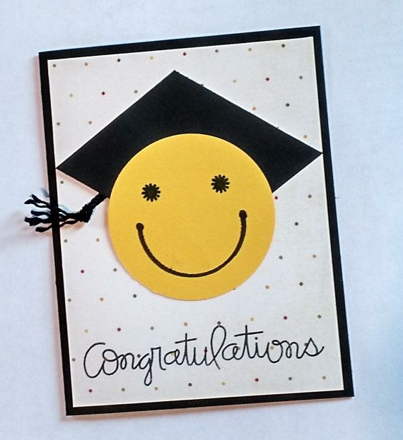 """Handmade graduation card. A perfect congratulations card for the new graduate of any age or gender. Yellow smiley face with black graduation cap and black twine tassel. The inside of the card is blank for you to write your personal message. The card measures approximate 4.25 x 5.5 """" and comes with a white envelope.    Note: handmade in a non-smoking home.  For more graduation and congratulations cards, go to my Special Occasions section https://www.etsy.com/shop/TwoYellowD..."""