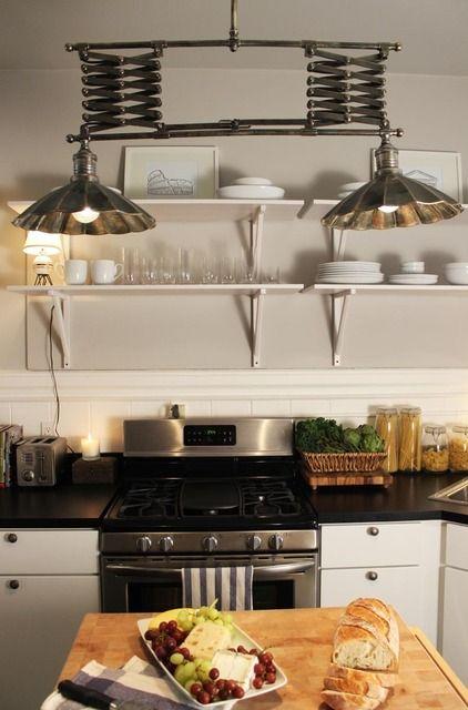 Simple flat cabinet faces, black countertops, open shelving.  So clean!  Crystalgentilellohousetour_29_rect640