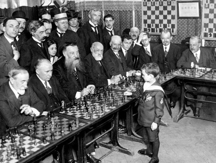 Samuel Reshevsky, 8 yrs old, simultaneously playing multiple Chess Masters in France, 1920.