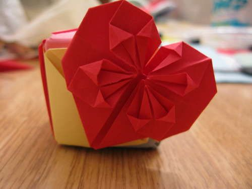 Interesting origami heart that also could work as a bookmark. I did it, but would like mine better with solid paper....