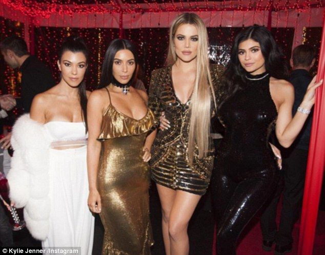 Sister act: Kim Kardashian West was front and centre at her family's annual Christmas Eve bash in Calabasas, with new pictures shared by the family on Instagram on Monday. She was joined by (L-R) Kourtney, Khloe and Kylie in a shot shared by the youngest sister