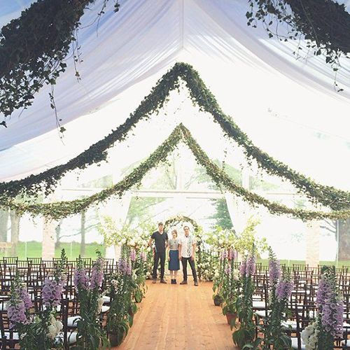 Ivy garlands and aisle lined with purple foxglove. #wedding_ceremony #tent_wedding