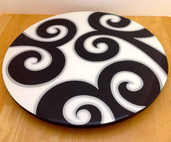 The Lazy Susan is 100% hand painted . Every Lazy Susan is painted on wood with acrylic colors.This Lazy Sussan comes painted in bright colors . After the Lazy Susan is hand painted, it is coated with a clear resin layer to seal and protect the painting. Each piece is original and created in our studio . Colors may vary slightly due to computer differences. Wipe clean with a damp cloth. Do not put in dishwasher or do not immerse in water. If you need a special order, any color or amount…