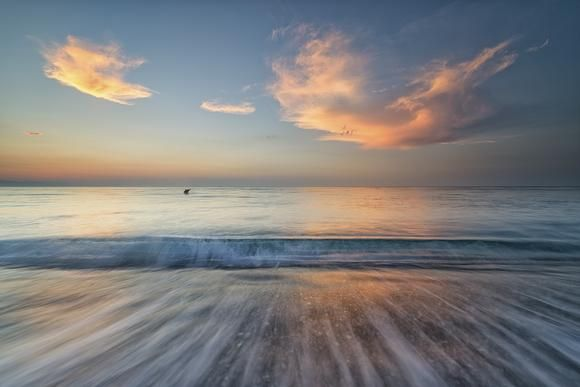 Sunrise over the beach of Giardini Naxos