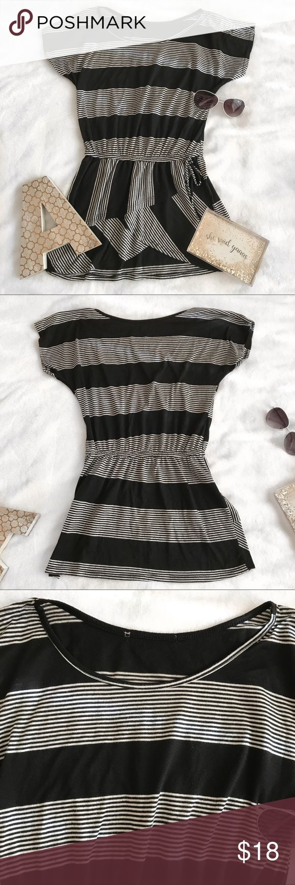 the limited black white striped smocked top 🕶✨ very short and stretchy short sleeve top with a bow detail around the waist. super cute pattern near the bottom half! cut off the brand tag but it was from the limited. high-low hem.  size: women's size small condition: excellent pre-owned condition, slight piling at neckline and bottom hem fit: relaxed but snug around waist flat measurements:     * 18 inches pit to pit     * 26 inches in length, front hem     * 28.5 inches in length, back hem…