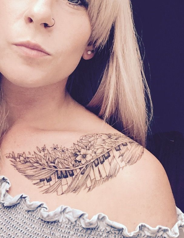 Feather tattoo with flowers & piano keys. Placed on shoulder & collar bone. Dot work tattoo