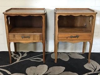 VINTAGE PAIR OF END TABLES FROM FURNITURE BY TOMLINSON. THEY FEATURE KEY HOLE CUT OUTS ON EITHER SIDE, LARGE STORAGE CABINET AND ONE DRAWER. 28H X 21W X 15D