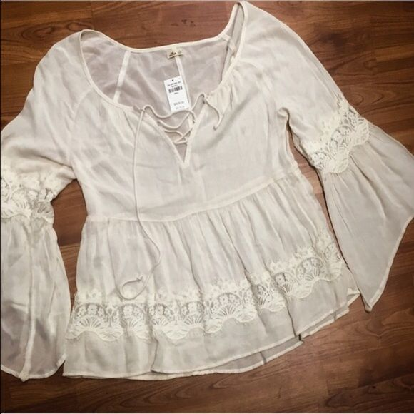 Beautiful Lace Blouse NWT Originally $45, this blouse is unbelievably intricate and gorgeous- not to mention soft. I would not be giving this up if it had been the right size!                                                                                                                                                                                                                                                                          Reasonable offers are very much welcomed. Hollister…