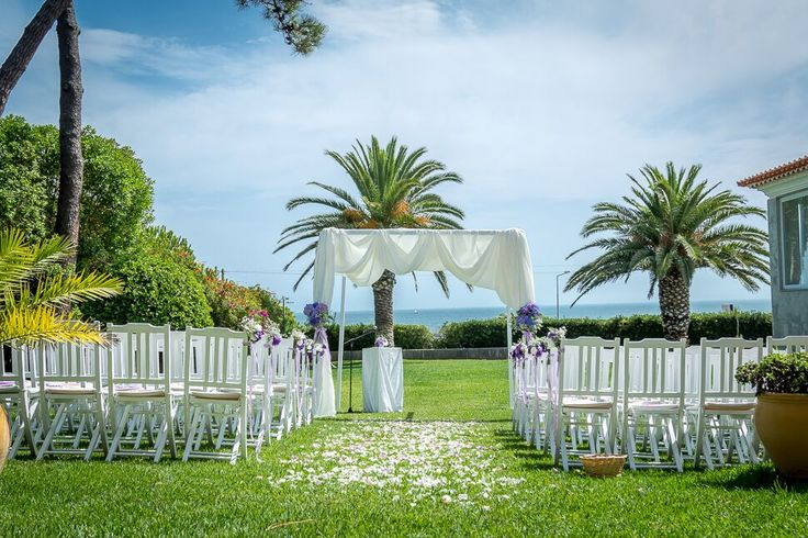 Destination Wedding Ceremony by the Sea. The amazing seafront wedding ceremony with our white ceremony canopy and purple wedding flowers. A unique and lovely Purple theme wedding ceremony with ocean view. Photos by Portugal Wedding Photographer #destinationweddingsinportugal #weddingceremonybytheseaportugal