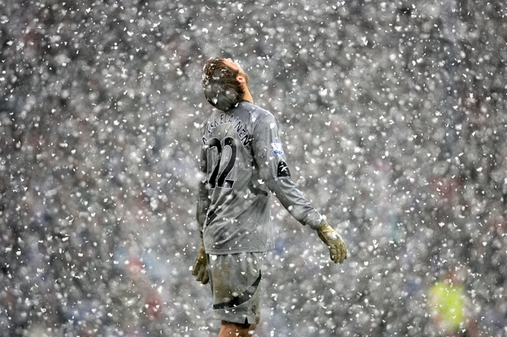 February 2010: Bolton goalkeeper Jussi Jaaskelainen looks to the heavens as heavy snow falls during his side's Premier League match against Blackburn Rovers at Ewood Park