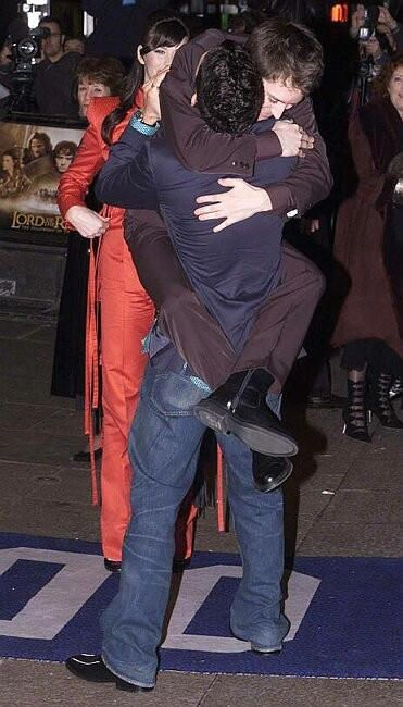 Lord of the Rings. The Hug. L to R: Liv Tyler (Arwen), Orlando Bloom (Legolas, back to the cam), and Elijah Wood (Frodo).