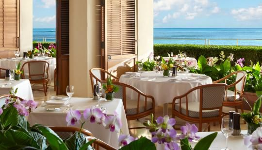 ORCHIDS (Honolulu, HI), an ocean-side restaurant, serves breakfast, lunch, and dinner with a panoramic view of Diamond Head and Waikiki Beach. Decorated with a profusion of colorful orchids, creative seafood specialties are presented in a setting which is informally elegant.