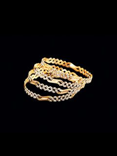 Brilliance Is An Understatement For This Set Of Bangles Made With A Great Design And 22 Carat Pure Gold.