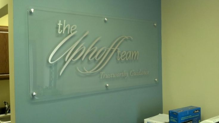 Interior lobby sign with clear acrylic, brushed aluminum vinyl and standoffs
