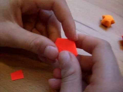 Origami Stern falten und damit zu Weihnachten dekorieren