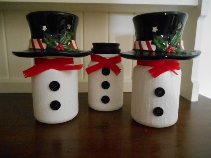upcycled Yankee Candle jars with Yankee toppers, Douwe Egbert coffee jar with lid painted black.
