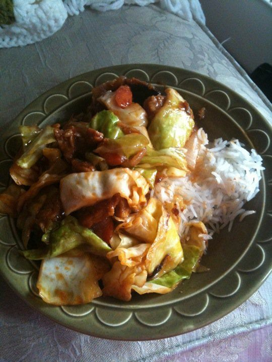 Stir fried tempeh with cabbage over rice.