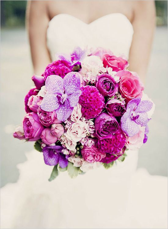 Vibrant purple and magenta pink bouquet including spotted orchids, coxcomb, roses, and spray roses.