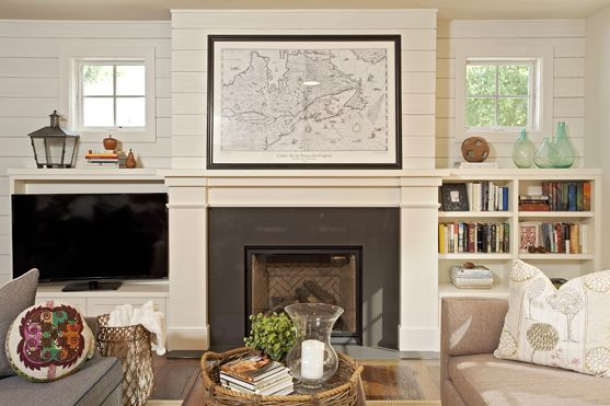 Bright, fresh, clean living room with built-in bookshelves and fireplace. Nautical cottage feel.  Designed by Mingle - Minneapolis based public showroom