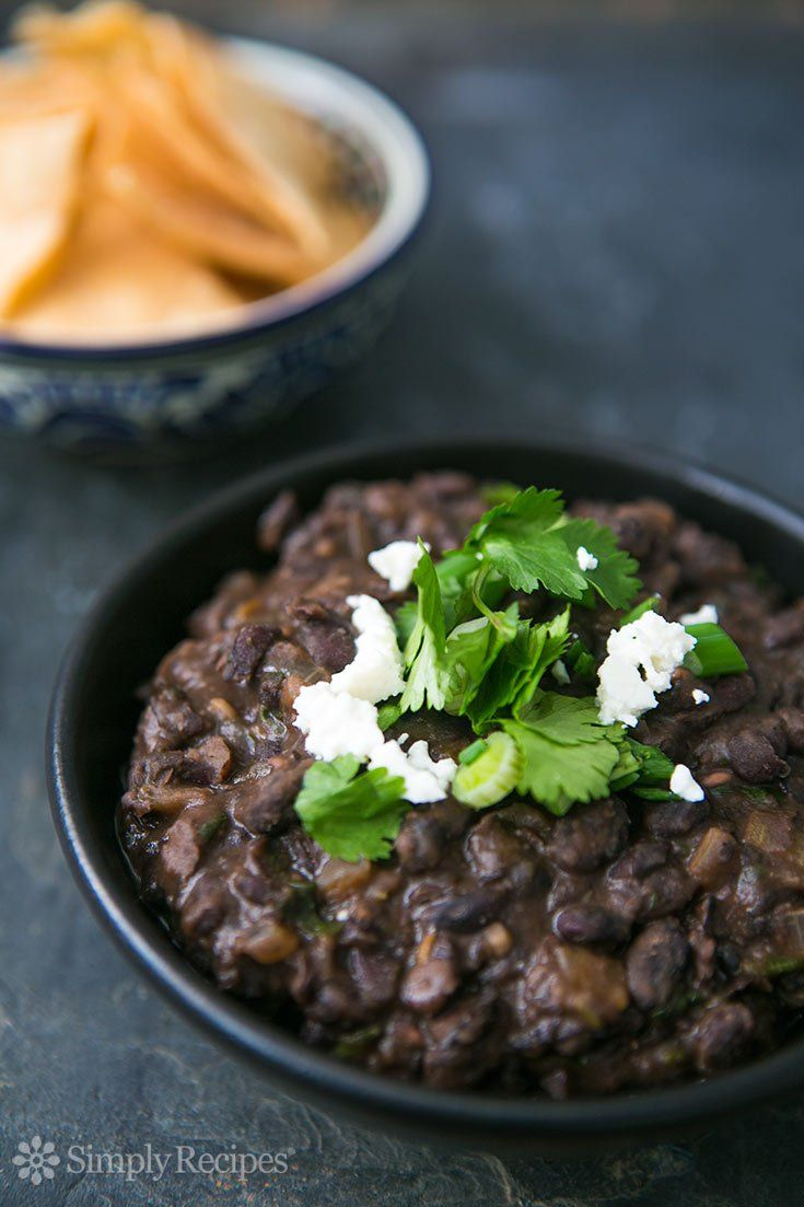 Refried Black Beans ~ Black beans, cooked and then fried and mashed with onion, garlic, chili, and cilantro. So good!! ~ SimplyRecipes.com