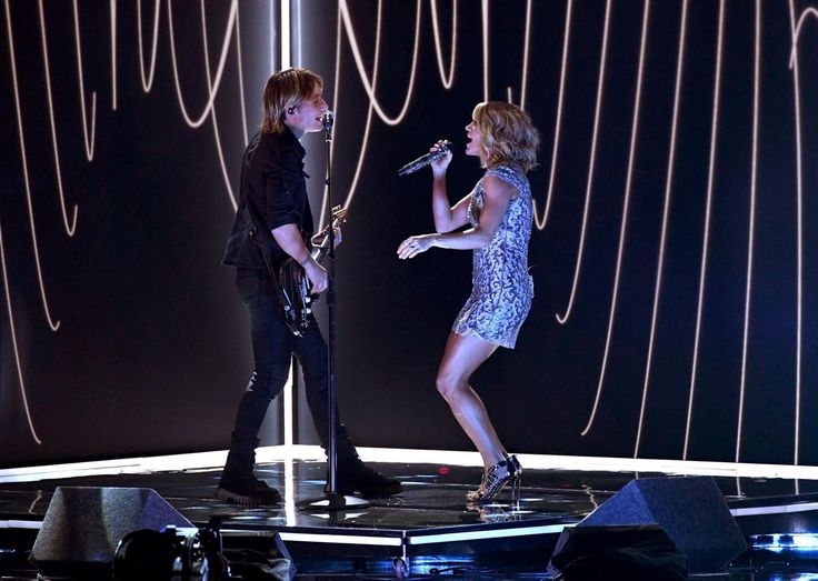 """Recording artists Keith Urban (l.) and Carrie Underwood perform their new song """"The Fighter"""" at the Grammy Awards on Feb. 12, 2017 in Los Angeles, California."""