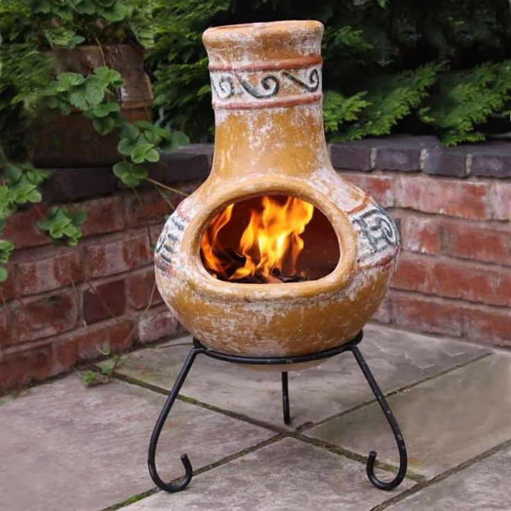 Interesting Chiminea For Outdoor Fireplace Ideas: Yellow Clay Chiminea With Black Iron Stand For Outdoor Furniture Ideas
