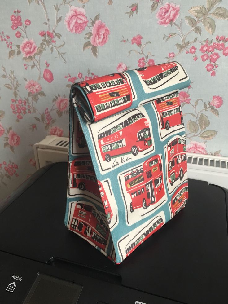 A personal favourite from my Etsy shop https://www.etsy.com/uk/listing/538131903/cath-kidston-oilcloth-london-bus-lunch