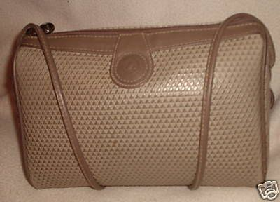 All the cool girls had a liz claiborne purse--Only rich girls had the wallet too.